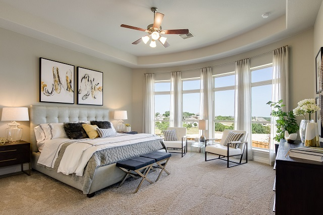 The master suite of Perry Homes' model