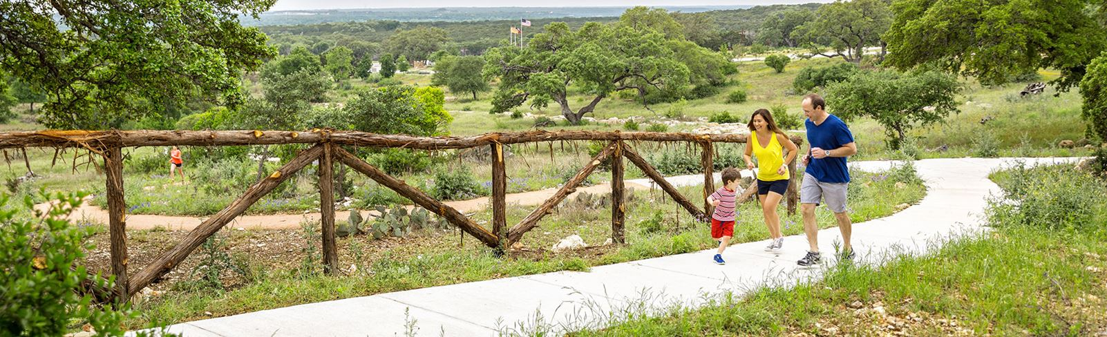 Rancho Sienna family walking on trail