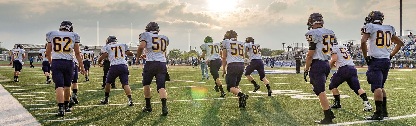 Rancho Sienna Liberty Hill High School football team playing on field in late afternoon