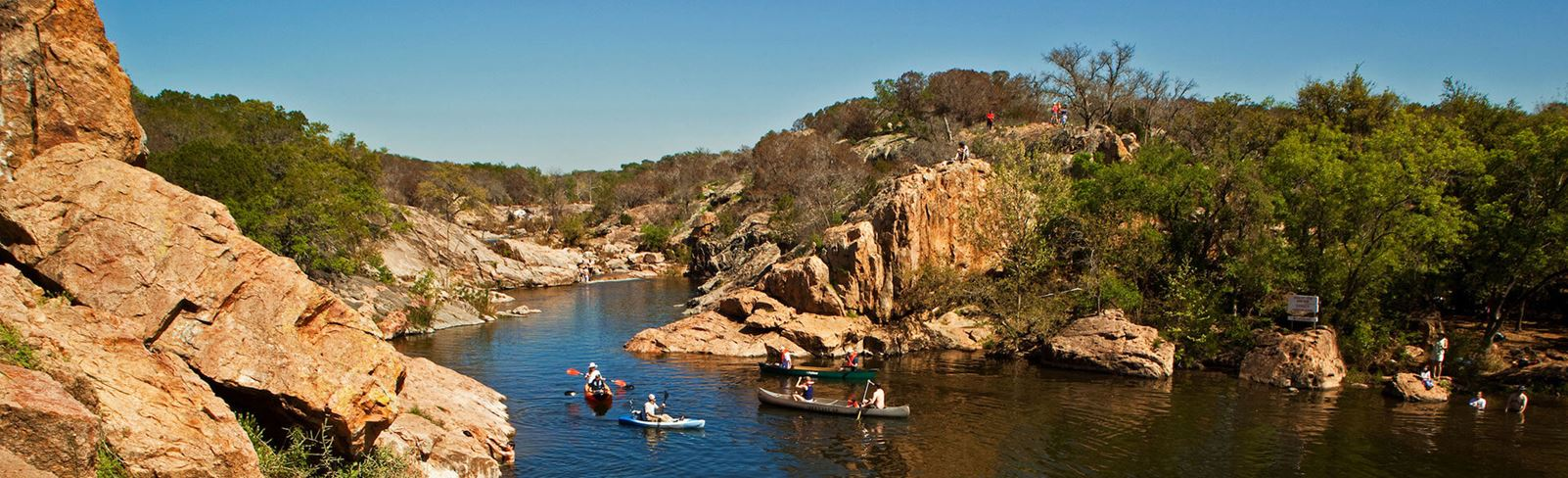 Rancho Sienna canoes and kayaks on water at Inks Lake State Park