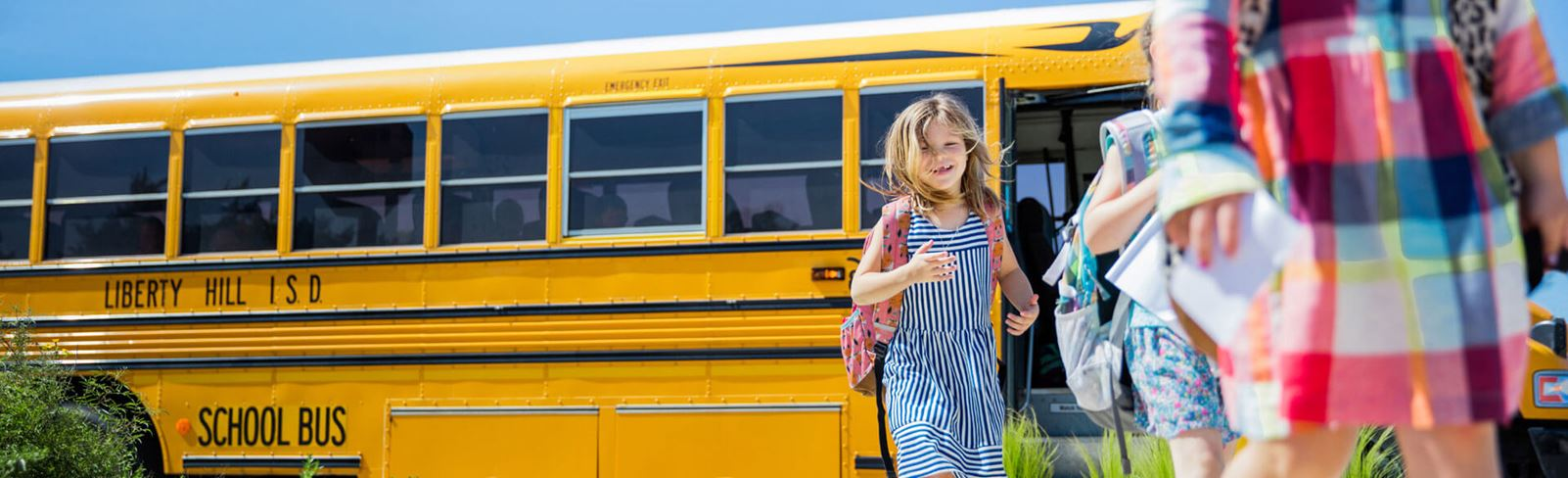 Rancho Sienna girl in front of school bus