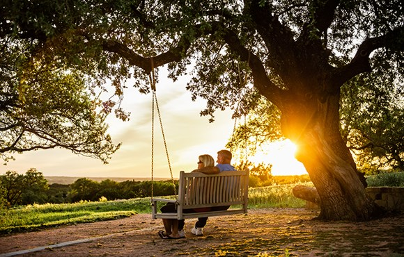 Rancho Sienna couple on swing at sunrise